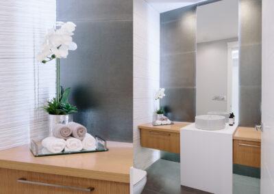 Alexandra Interiors luxurious contemporary monochromatic powder room bathroom. Interior design Vancouver